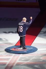 The golf legend acknowledged the crowd as he left center ice.