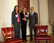Tana Thomson (left) and Anne Donovan stand with Business Journal publisher Craig Wessel as they accept the Organizational Excellence in HR Award on behalf of Xenium HR.