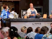 "Chef, writer and Travel Channel personality Andrew Zimmern demonstrates a three-course meal preparation in the ""Kitchen Memories"" series at the Festival Center."