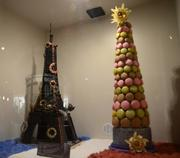 A chocolate Eiffel Tower and macaroon tower by the staff at Epcot's Les Chefs de France on display in the Festival Center