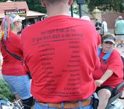 "Gary Hartley of Jacksonville models a custom festival shirt he had made for his group. His party of family and friends were enjoying a ""tradition in the making"" at their second Food & Wine Festival together."