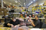 Workers make printers in the 3D Systems manufacturing area.