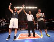 Mike Portuondo, Ernst & Young, acknowledges his win over Jimmy Davila, Holland & Knight.