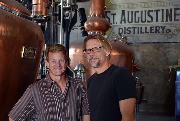 Michael Diaz, left, and Philip McDaniel stand inside of the St. Augustine Distillery.