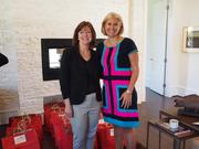 Denise Warner, member of the Board of Visitors for Children's National Medical Center and Long & Foster Realtor, stands with Anne Polk, chairwoman of the 2013 Care for Kids Card Program, member of the Board of Visitors for Children's National, and Long & Foster Realtor.