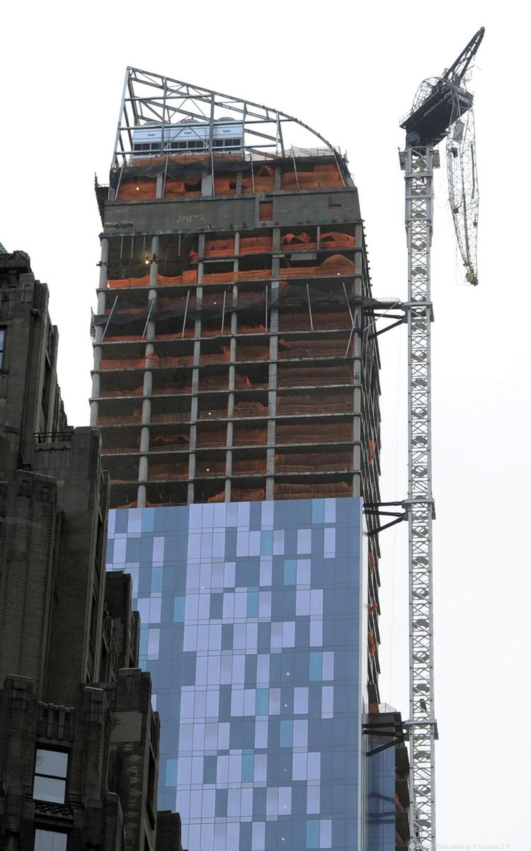 A partially collapsed crane hung from the 90-story residential building One57 under construction on West 57th Street in New York last October, after Hurricane Sandy.