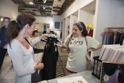 """Lucy Hollis and her daughter Janey Hollis, 17,  buy a dress for homecoming at the Harold and Mod pop-up shop using the Weil Building on Third Avenue North as part of the """"REVIVE: The Street Life Project."""""""