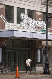 """Workers clean and ready the Lyric Theater for Friday night's lighting as part of the """"REVIVE: The Street Life Project."""""""