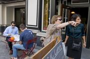 """Birmingham residents enjoy the Freshfullly pop-up shop on Third Avenue North as part of the """"REVIVE: The Street Life Project"""" Friday."""