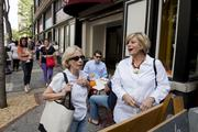 """(left to right) Linda Jones and Donna Whitlock review the menu before heading into the Freshfully pop-up shop on Third Avenue North during """"REVIVE: The Street Life Project"""" Friday."""