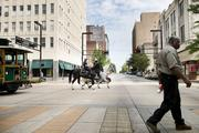 """Mounted police patrol 20th Street North during """"REVIVE: The Street Life Project"""" Friday afternoon."""