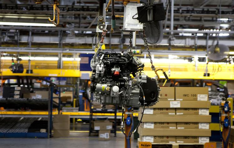 An engine is shown moving to the line at the Louisville Assembly Plant to be placed in a new Ford Escape model.