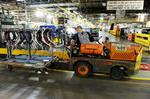 Ford celebrates assembly line's past (100 years old) and future (Transit Van)
