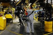 A Ford F150 truck chassis is flipped on the production line at the Kansas City Assembly Plant.
