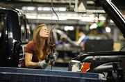 Autoworker Teresa Bailey secures seat belts into a Ford F150 at the Kansas City Assembly Plant.