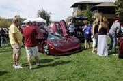 A crowd gathers around a Mosler seen at the Niello Concours at Serrano in El Dorado Hills.