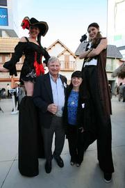 John Sellers with Sellers Financial Services Inc. and Sharon Sellers meet some of the stilt-walkers at the event.