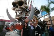 Lauren Morgan with Tampa Bay Builders Association, Ronald Weaver with Stearns Weaver Miller Weissler Alhadeff & Sitterson PA, and Jennifer Doerfel with TBBA outside the Buccaneers' pirate ship.