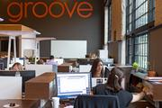 """The main section of Groove Commerce's new office, the """"pit"""" houses the company's creative team and has breakout rooms around the perimeter for meetings."""
