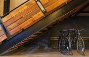 Below the staircase on the first floor, Groove Commerce CEO Ethan Giffin had a custom bike rack installed by the same team that built the office's custom timber tables.