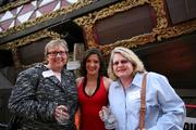 Sharon Herman and Melissa Hughes, both with Silver Key Wealth Management, pose with a Tampa Bay Buccaneers cheerleader at the party.