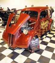 Rene and Susan LePrevott of Placerville own this 1948 Anglia that's also a tribute to Panella Trucking. It was one of many vehicles featured at the 63rd Sacramento Autorama at Cal Expo.