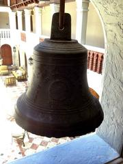 A bell hanging in the courtyard of the former Versace mansion.