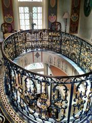 Ornate railing around a balcony space at the Versace mansion.