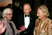 Ross Perot, center, the former presidential candidate and president of the Perot Foundation, mingles with guests.