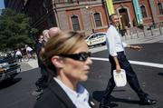 President Barack Obama, right, walks back to the White House after picking up lunch at Taylor Gourmet Deli on Pennsylvania Avenue.