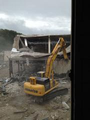 Environmental Holdings Group brought in special heavy equipment to teardown Eastland Mall including an excavator shipped in from Florida where it was used to wreck the former launch pads used by NASA.