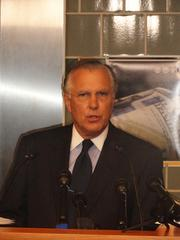 Fisher speaking to the media during the Oct. 8 press conference in Houston