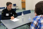 Mike Policicchio works one on one with a student to provide feedback and to coach him on interviewing skills.