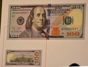 A graphic of the new $100 bill.