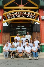 Global Communities' volunteer team, led by President and CEO David Weiss (left, back row).