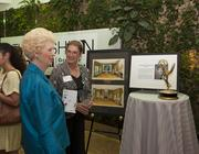 Philanthropist and Goodwill award recipient Gladys Lisanby admires the Emmy Award of her late brother-in-law Charles Lisanby.
