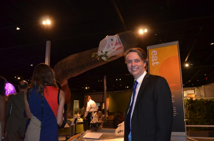 """Kansas Lt. Jeff Colyer is pictured in front of the 60-foot-long Mamenchisaurus at the """"World's Largest Dinosaurs"""" exhibit at Prairiefire."""