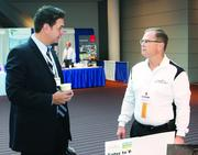 William Summers, left, of VFG Leasing & Finance and Rich Brueggman of Data Science Automation Inc.