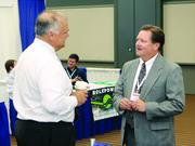 Patrick Imbrogno, left, of Geo-Com LLC and Jerry Soles of Hess Corp.