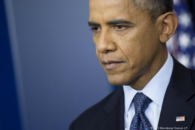 President Barack Obama listens to a question during a White House news conference Tuesday.