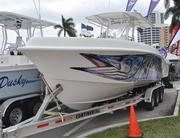 A 33-foot Dusky sits on a trailer at the Palm Beach International Boat Show.