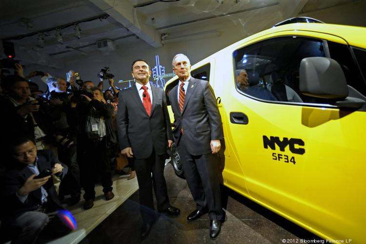 Carlos Ghosn, president and chief executive officer of Nissan Motor Co., left, and Michael R. Bloomberg, mayor of New York City, unveil the Nissan NV200 Taxi in New York, in 2012.