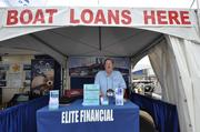 Allan Baum of Elite Financial in Pompano Beach mans his booth at the Palm Beach International Boat Show.