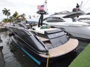 A Riva boat tied to the dock at the Palm Beach International Boat Show.