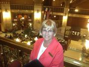 Mary Hawley, senior catering sales manager and 40-year Brown Palace employee, above the Grand Lobby.