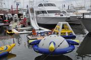 Inflatable toys for the water. Accessories are a big part of boat shows in South Florida.