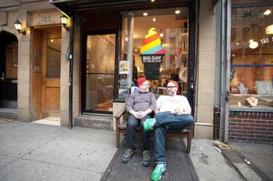 Bryan Petroff (l) and Douglas Quint (r) sit outside the East Village location of their Big Gay Ice Cream shop.