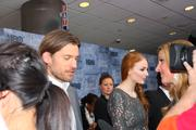 "Actors Nikolaj Coster-Waldau (left) and Sophie Turner, who play Jaime Lannister and Sansa Stark on HBO's hit series ""Game of Thrones,"" take questions from the media during a red carpet event at the Cinerama theater in Seattle March 21."