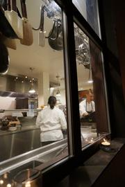 The cooks inside the Bottega kitchen, preparing the Best in Business meal.