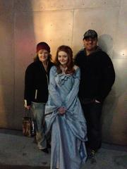 """Game of Thrones"" fans Sherry Roit (left), Anastacia Ferry and D. Nelson Oman got into the Season 3 premiere at the Cinerama in Seattle after actor Nikolaj Coster-Waldau saw their sign and Ferry's handmade Sansa Stark dress and gave them tickets."